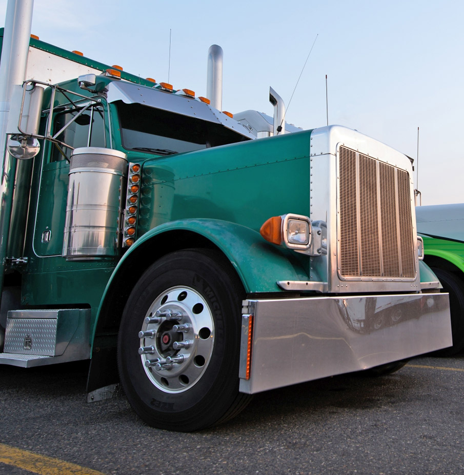 Front view of a big green 18-wheeler