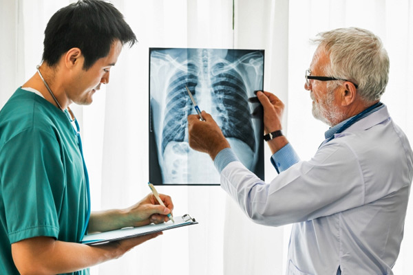 Doctor looking over someone's X-rays